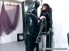 Redhead bitch in latex cloth gets pussy