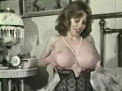 Kitten Natividad Plays with Her Huge Tits 1970 tube porn video
