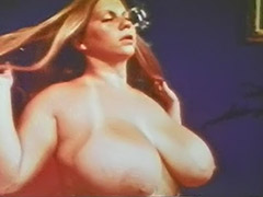 Big Busty Babe Poses and Teases Herself 1970 tube porn video