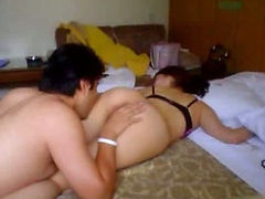 Precious Asian couple making sweet love