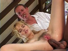 Soft c cup blonde kneels to suck two black cocks then both dudes fuck her pussy