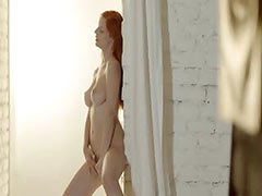Unbeliveably breasty redhead teasing