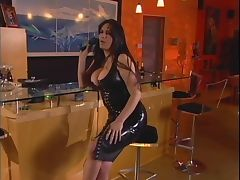 Latex clad lesbians using a dildo tube porn video