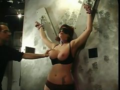Big tits slut gets her tits and nipples squeezed by her master