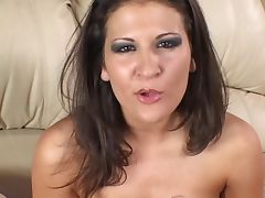 Sexy slut with massive tits rubs on her pussy on the sofa