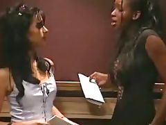 Interracial lesbian sex in elevator tube porn video