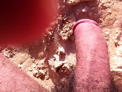 stroking the cock at the beach