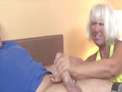 Granny welcomes guy wtih a handjob