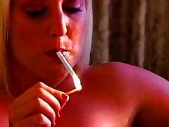 Busty blonde smokes and masturbates solo