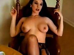 Smoker has big tits and sexy stockings