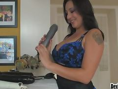 Busty milf in hot fishnet stockings plays with huge toys