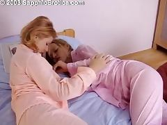 Two hot blondes licking each other and playing with a strap