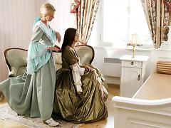 Two super hot babes in old dresses are going lesbian