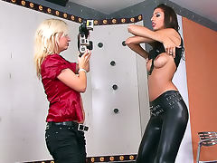 Gorgeous chick in leather pants poses