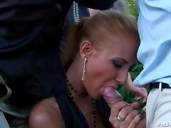 Interracial group sex in the grass