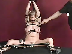 Tied and strapped down for BDSM play