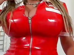 She zips up a latex nurse dress