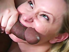 Kinky blonde biting black guy's cock and balls