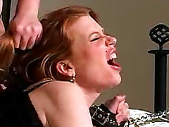 Spanking the ass of submissive redhead