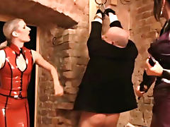 Fat guy dressed as a girl brutally tortured by two dominas