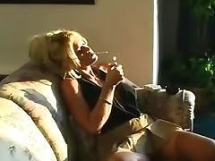 Smoking and fondling her tits