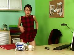 Horny office girl masturbates sitting on the table