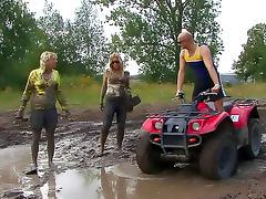Sexy girls get muddy outdoors