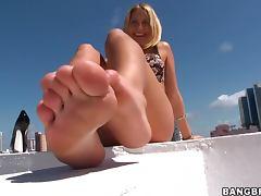Cute blonde with huge tits pleases the guy with a fantastic footjob