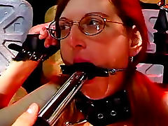 Nasty redheaded chick gets chained and brutally penetrated tube porn video