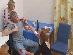 Two women abuse a young