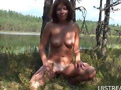 Sexy Nasty demonstrates her beautiful body near the lake