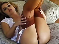Lustful blonde lady teases us in expensive nylon stockings tube porn video