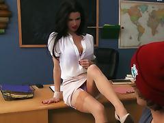 Beautiful teacher seduces student in the classroom