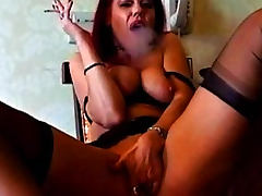Redhead smokes and talks dirty to you tube porn video