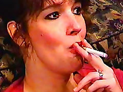 Cute chick with freckles smokes cigarette porn tube video