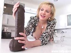 Milf strokes huge black dildo