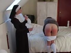 Nun spanks a naughty schoolgirl