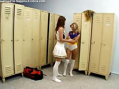 Two pretty cheerleaders play with dildos in the locker room