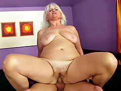 Wonderful and busty Judi is satisfying her young fucker