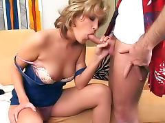 Slut in tight dress eats dong