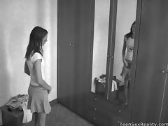 Teen tries on clothes