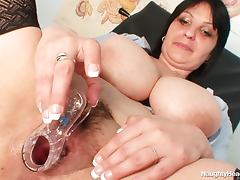 Chubby nurse toys her vagina