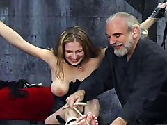 She puts on corset for bondage scene