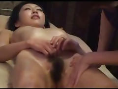 Asian Girl Getting Her Nipples Sucked Hairy Pussy Fingered By The Masseuse On The Massage Bed