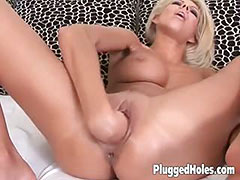 Butt naked blonde toying herself