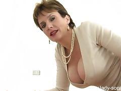 Glamorous milf teases her pantyhose