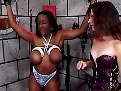 Bondage and pain for busty black submissive