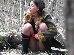 Hottie in hoses pisses in voyeur clip