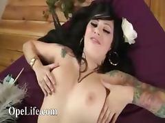 Horny brunette babe fingering on settee