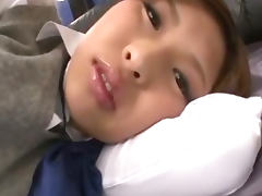Ami Kurosawa teases a cock and the cameras in her schoolgirl uniform